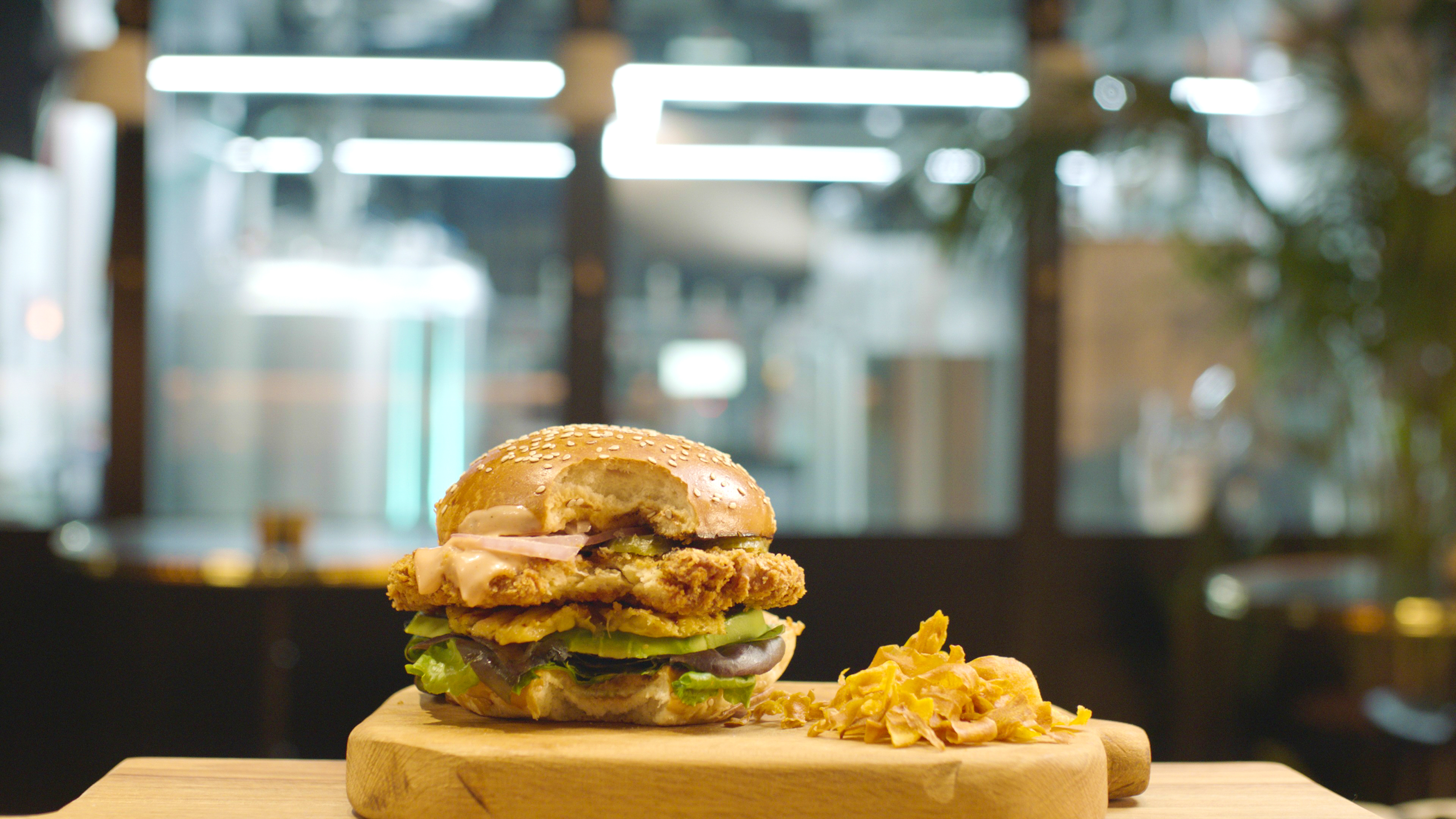SuperMeat's chicken burger, pilot plant in the back.jpg