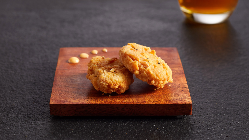chicken-bites-two-on-slate-w-drink.jpg